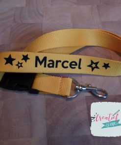 geel keycord met naam voor Marcel