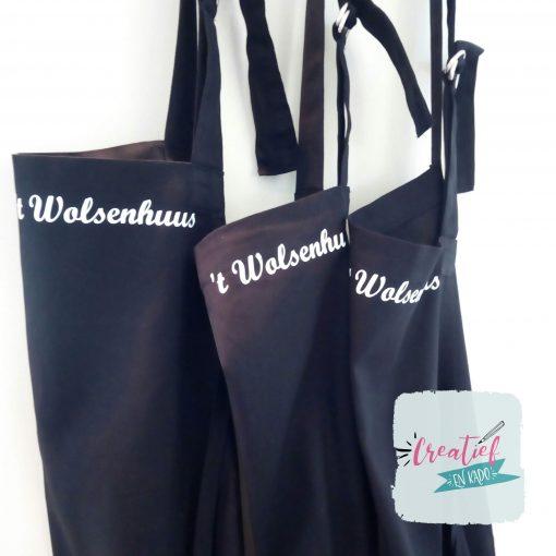 keukenschort 't wolsenhuus, keukenschort logo